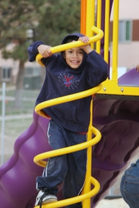 A child enjoys the new playground at Holly Park Apartments in Commerce City, Colo., last fall.