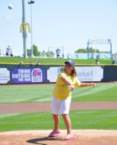 Taylor Kologenski, Peace Pal Leader throwing the first pitch at the Storm Chasers game this summer.