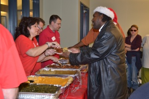Bank of America volunteers serve a hearty meal to Harold Washington Apartment residents
