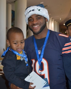 Joe Anderson, WR for Chicago Bears visits with an Austin resident