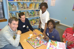 Linden, LLC employees play board games with students at the Austin Holiday Party