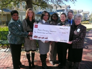From left:Sheri Butler, Jenny Gentry and Connie Bryant with Wells Fargo; Rachel Cunningham, Gray Nolan and Shawn Smitley with Mercy Housing Southeast;Sister Margaret Beatty with St. Joseph's/Candler