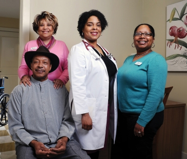 Mercy Housing's Atrium at CollegeTown staff – Cheryl Knight and Jenifer Williams – with Dr. Buckner and resident Johnnie Dickerson.