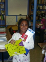 A young student at Mercy Housing Lakefront's Austin After-School Program poses with her supplies.