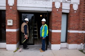 The construction crew works on completing an interior common space at the Pullman Wheelworks Apartments