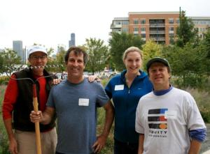 Equity Residential employees take a break from landscaping the prairie garden at the Schiff Residences.