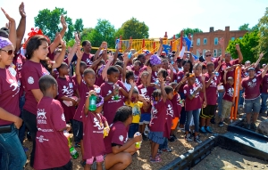 Volunteers join with Mercy Housing children to celebrate the completion of the playground. Photo Credit: Daniel Olsen