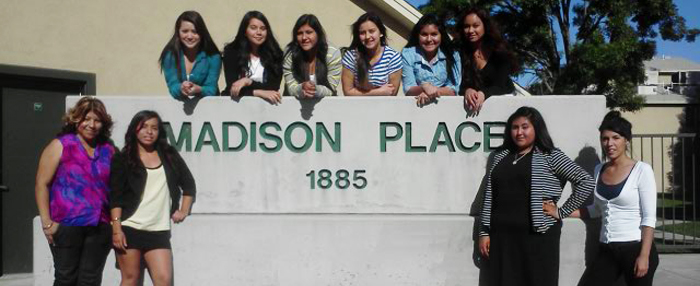 Thriving in Life and Youth Leadership Program participants in front of Mercy Housing Madison Place in Bakersfield
