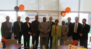 Felix Matlock, VP of Resident Services at Mercy Housing Lakefront, accepts the 2013 MetLife Foundation Award alongside community partners.