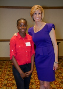 Mercy Housing resident speaker Mami pictured with Live in Hope event emcee Cheryl Preheim (9NEWS KUSA-TV)