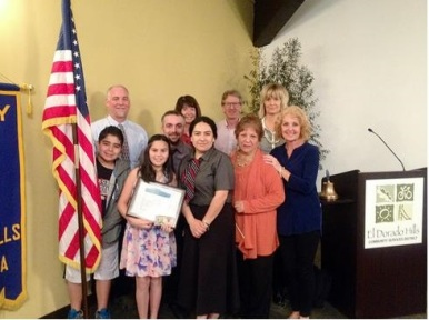 Rotary Student of the Month Bella Buhl, holding plaque, is surrounded by her support system. Front row, left to right: brother Dante Buhl, mom Gissela Buhl, grandmother Maria Diaz and grandmother Linda Giannini; back row, left to right: dad John Buhl, uncle AJ Buhl, Principal Barbara Narez, Buckeye Superintendent David Roth and teacher Cindi Prahl.  Picture originally captured by Noel Stack|Village Life