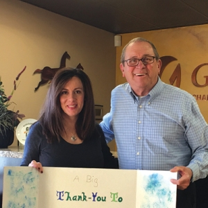 Glenn presents a thank you card to Sarah Watts of the Gilbert Chamber of Commerce, one of our supporters