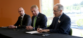 The ceremonial signing of the letter of intent (LOI) (from left), with Bill Hilf, CEO of Vulcan Inc., Ed Murray, Seattle Mayor, and Bill Rumpf, MHNW President.