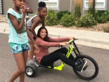 HOLLAND & HART LLP AND WISH FOR WHEELS TEAM UP TO BRING BIKES TO MERCY HOUSINGKIDS